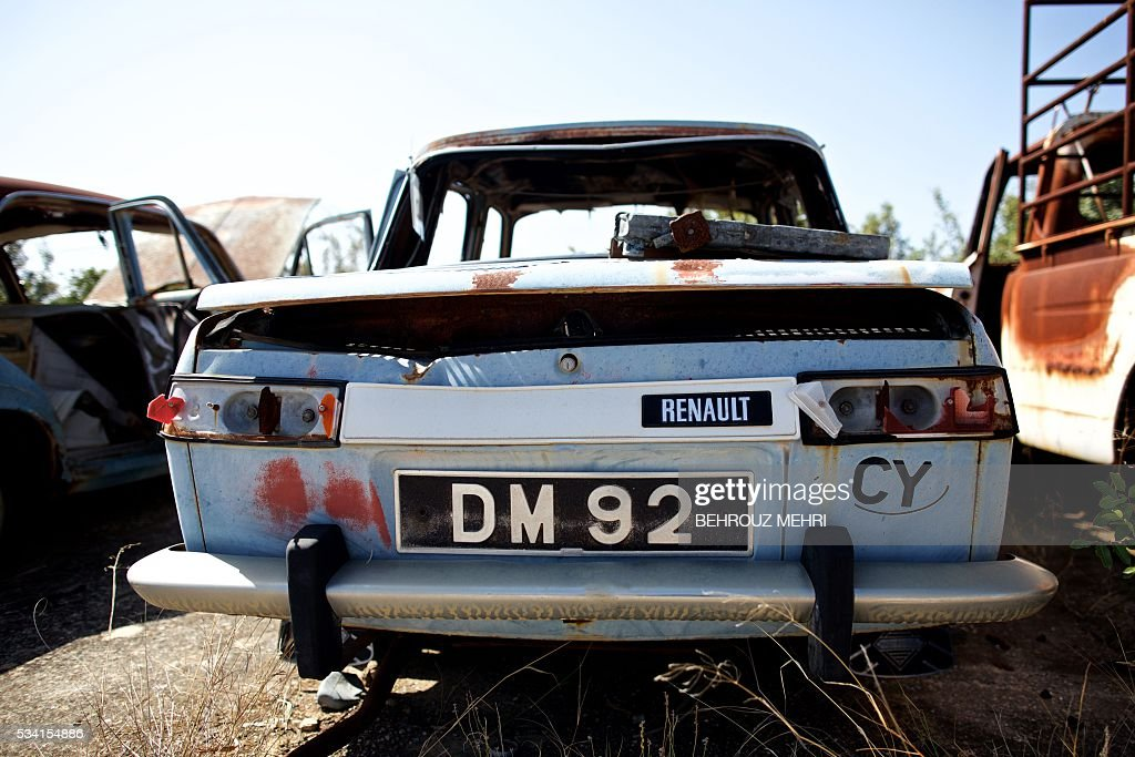 A picture taken on May 25, 2016 shows a late 1960s Renault 10 car parked at the Sovereign Base Area of Akrotiri, a British overseas territory located ten kilometres west of the Cypriot port city of Limassol. Abandoned in the streets of the base after the war, hundreds of vehicles that belonged to Turkish Cypriots, mostly dating from the 1960s, had been gathered in a vast wasteland in 1975 await their owners on the British base of Akrotiri, 42 years after being left behind in the divided island. The British authorities have recently undertaken an inventory of 400 vehicles in the hope of regaining their former owners, listing images and details of them on an internet site. / AFP / BEHROUZ