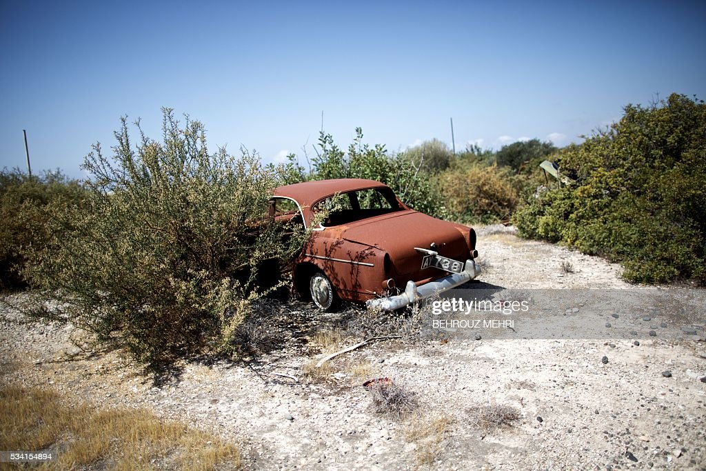 A picture taken on May 25, 2016 shows a Volvo car parked at the Sovereign Base Area of Akrotiri, a British overseas territory located ten kilometres west of the Cypriot port city of Limassol. Abandoned in the streets of the base after the war, hundreds of vehicles that belonged to Turkish Cypriots, mostly dating from the 1960s, had been gathered in a vast wasteland in 1975 await their owners on the British base of Akrotiri, 42 years after being left behind in the divided island. The British authorities have recently undertaken an inventory of 400 vehicles in the hope of regaining their former owners, listing images and details of them on an internet site. / AFP / BEHROUZ