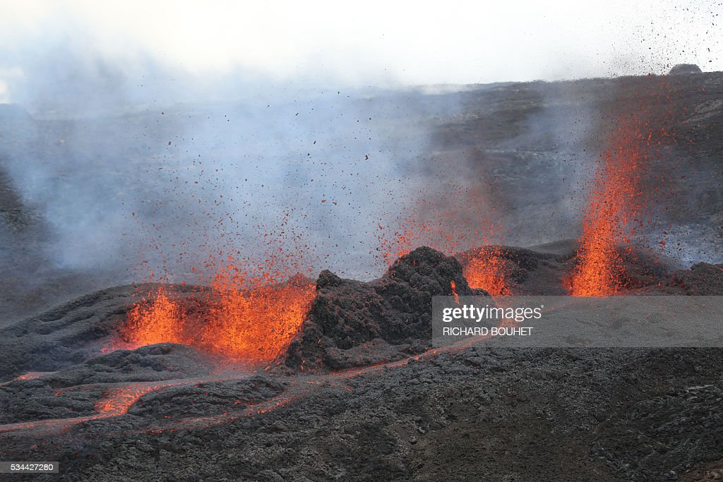 A picture taken on May 26, 2016 on the French island of La Reunion shows lava during the eruption of the Piton de la Fournaise volcano, in an unhabitated area. The last Piton de la Fournaise's eruption occured on October 30, 2015. / AFP / RICHARD