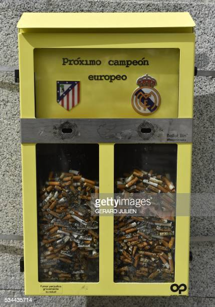 A picture taken on May 26 2016 shows an ashtray displayed by the City Council and shaped as a ballot box inviting the passerby to vote with their...