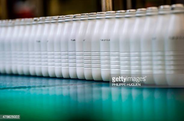 A picture taken on May 28 2015 shows milk bottles in the Candia milk plant in Awoingt northern France The 15th World Milk Day takes place on June 1...