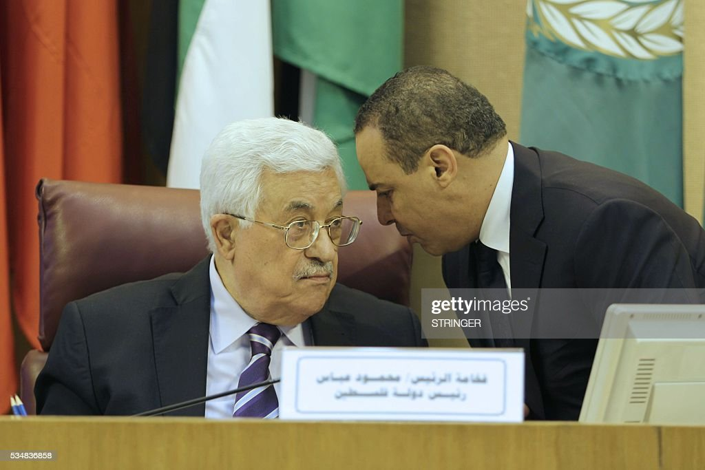 A picture taken on May 28, 2016 shows Palestinian president Mahmud Abbas (L) during a meeting of Arab foreign ministers to discuss a French peace initiative in the Egyptian capital Cairo. / AFP / STRINGER