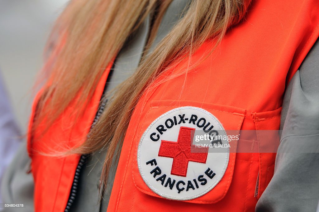 A picture taken on May 28, 2016 shows the logo of the French Croix Rouge (Red Cross) on the jacket of Slovak model and ambassador for the French Croix Rouge (Red Cross) Adriana Karembeu during a collect of money for the charity in Toulouse, southern France, on May 28, 2016 as part of the Red Cross national days which aims to present the actions of the charity. / AFP / REMY