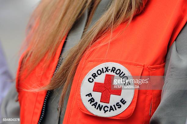 A picture taken on May 28 2016 shows the logo of the French Croix Rouge on the jacket of Slovak model and ambassador for the French Croix Rouge...