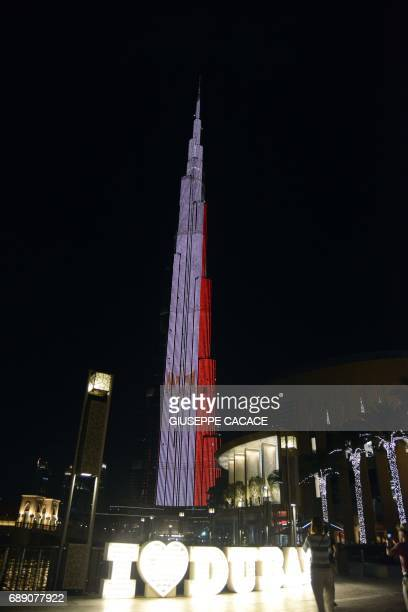 A picture taken on May 28 2017 shows the Burj Khalifa tower in Dubai lit with the colours of the Egyptian flag in solidarity with the victims of the...