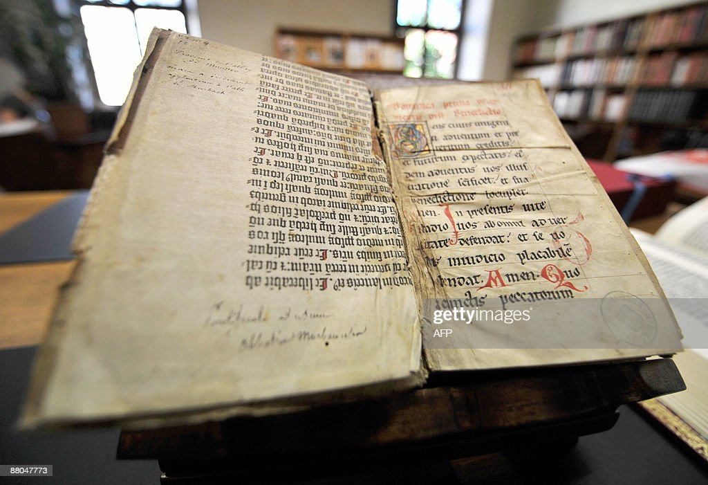 A picture taken on May 29, 2009 in Colmar, northeastern France shows pages of the Gutenberg Bible discovered in a library by a library assistant, who was searching the collection for something else. Experts confirmed the discovery by comparing the extract with a photocopy of the Gutenberg Bible, which was written with the same gothic font and printed by Johannes Gutenberg in Germany in the 15th century. AFP PHOTO JOHANNA LEGUERRE