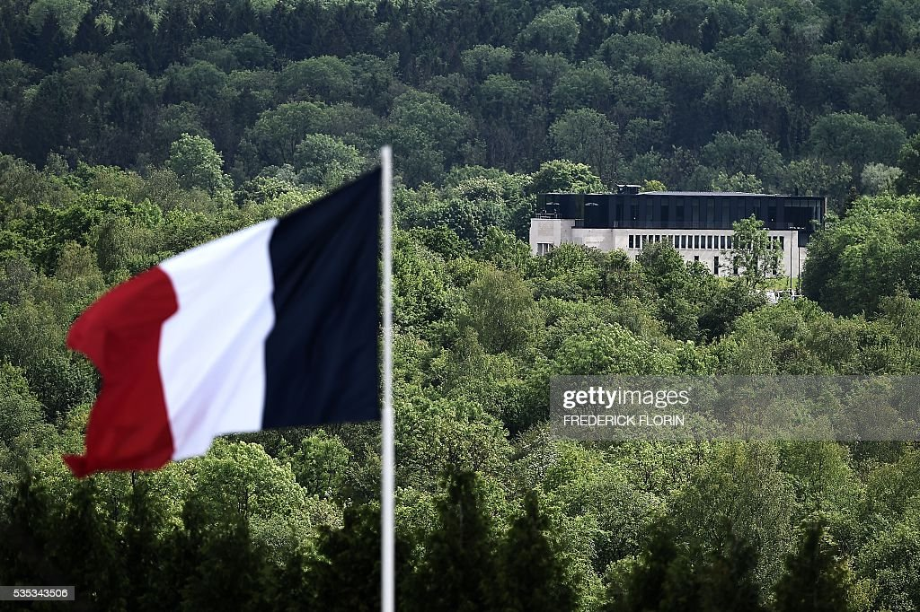A picture taken on May 29, 2016 shows a French flag floating next to the Verdun Memorial in Douaumont, northeastern France, during a remembrance ceremony to mark the centenary of the battle of Verdun. The battle of Verdun, in 1916, was one of the bloodiest episodes of World War I. The offensive which lasted 300 days claimed more than 300,000 lives. / AFP / FREDERICK