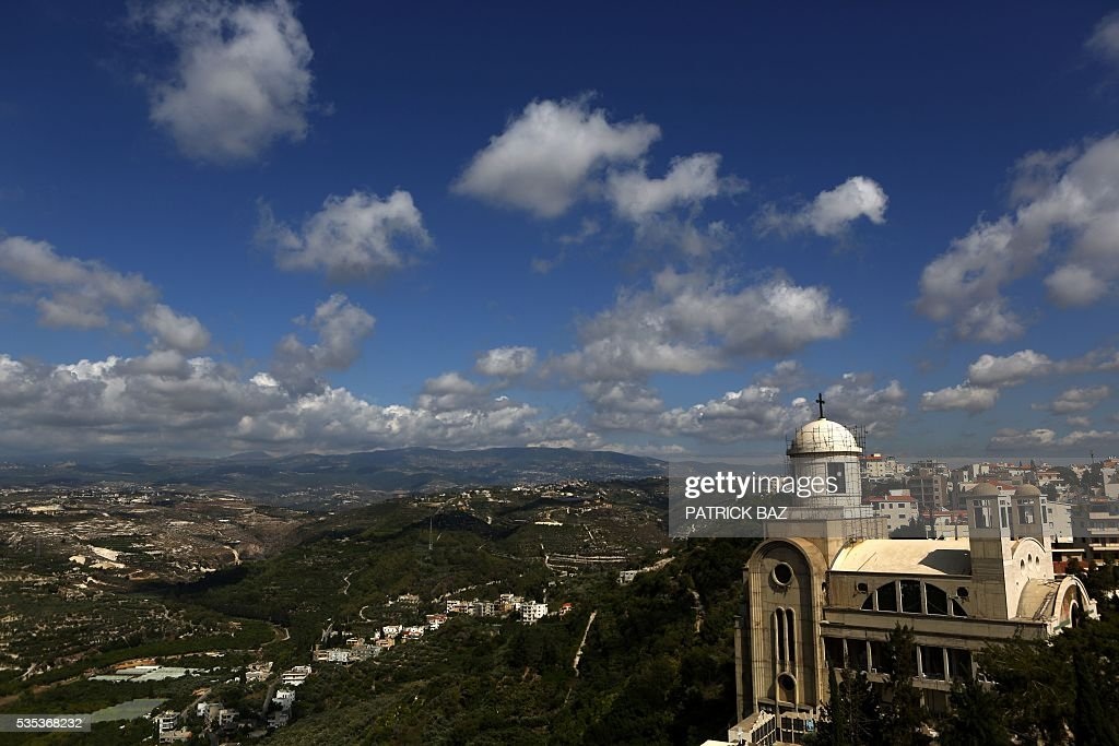 A picture taken on May 29, 2016 shows a general view of the Basilica of Our Lady of Mantara in the southern Lebanese town of Maghdouche East of Sidon prior to a ceremony organised by the Ministry of Tourism to put the Grotto of Maghdouche on the international religious tourism map. Magdouche, along with Lourdes in France, Fatima in Portugal and Medugorje in Bosnia & Herzegovina are expected to be put on the international religious tourism map. According to local tradition the Virgin Mary accompanied Jesus during his journey to Tyre and to Sidon and waited for him in the grotto at Magdoucheh. The grotto was discovered 400 years ago. / AFP / Patrick BAZ