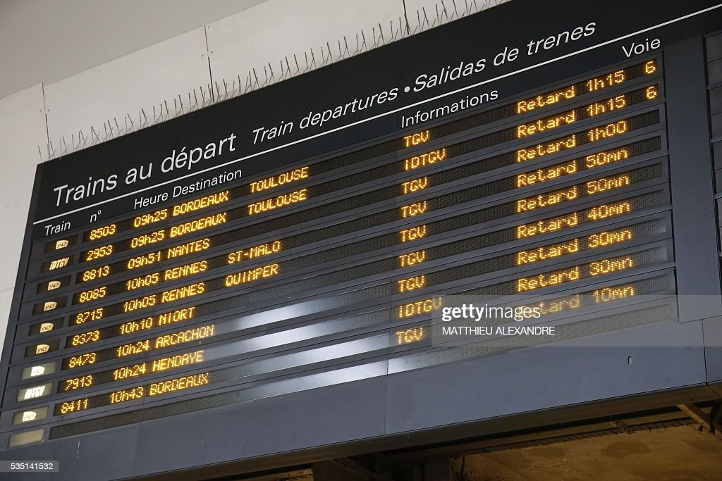 A picture taken on May 29, 2016 shows the display panel indicating delayed trains as the train traffic was suspended since this morning at the start and towards the Paris-Montparnasse rail station, due to a failure of traffic management system for the moment unexplained, according to France's national state-owned railway company SNCF.
