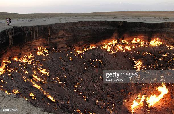 A picture taken on May 3 shows people visiting 'The Gateway to Hell' a huge burning gas crater in the heart of Turkmenistan's Karakum desert The...
