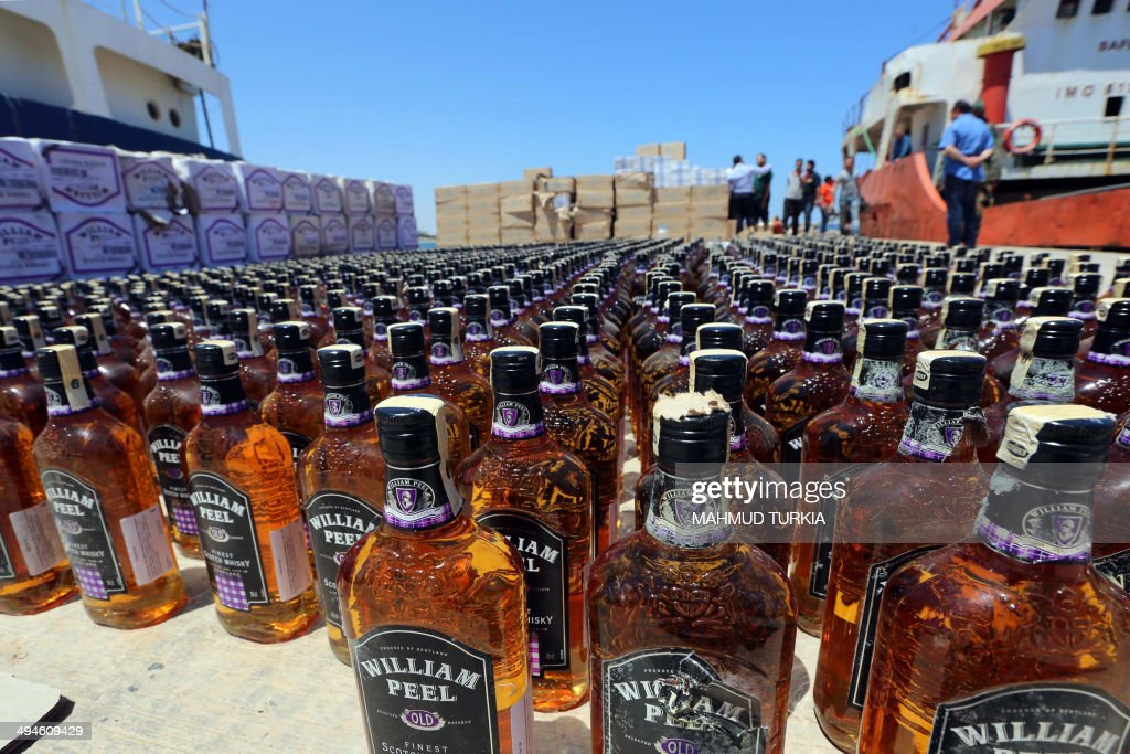 A picture taken on May 30, 2014 in Tripoli, shows bottles of whiskey that were seized by the Libyan coast guard from a vessel of the coast of the Libyan capital as it attempted to smuggle the contraband into the North African country where alcohol sales and consumption in illegal. With its porous borders, Libya has seen a significant increase in drug and alcohol trafficking since Moamer Kadhafi's regime was ousted in 2011, with much of the booze supplies being smuggled in from neighbouring Tunisia, Algeria or Malta.