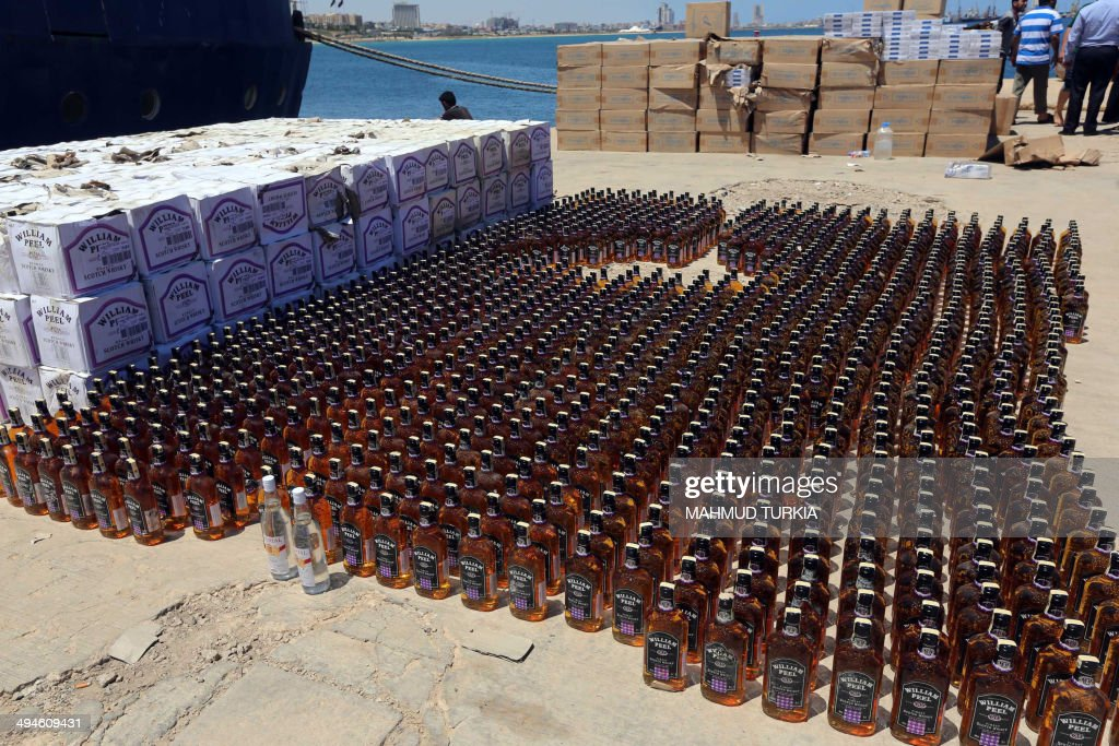 A picture taken on May 30, 2014 in Tripoli, shows bottles of whiskey that were seized by the Libyan coast guard from a vessel off the coast of the Libyan capital as it attempted to smuggle the contraband into the North African country where alcohol sales and consumption is illegal. With its porous borders, Libya has seen a significant increase in drug and alcohol trafficking since Moamer Kadhafi's regime was ousted in 2011, with much of the booze supplies being smuggled in from neighbouring Tunisia, Algeria or Malta.