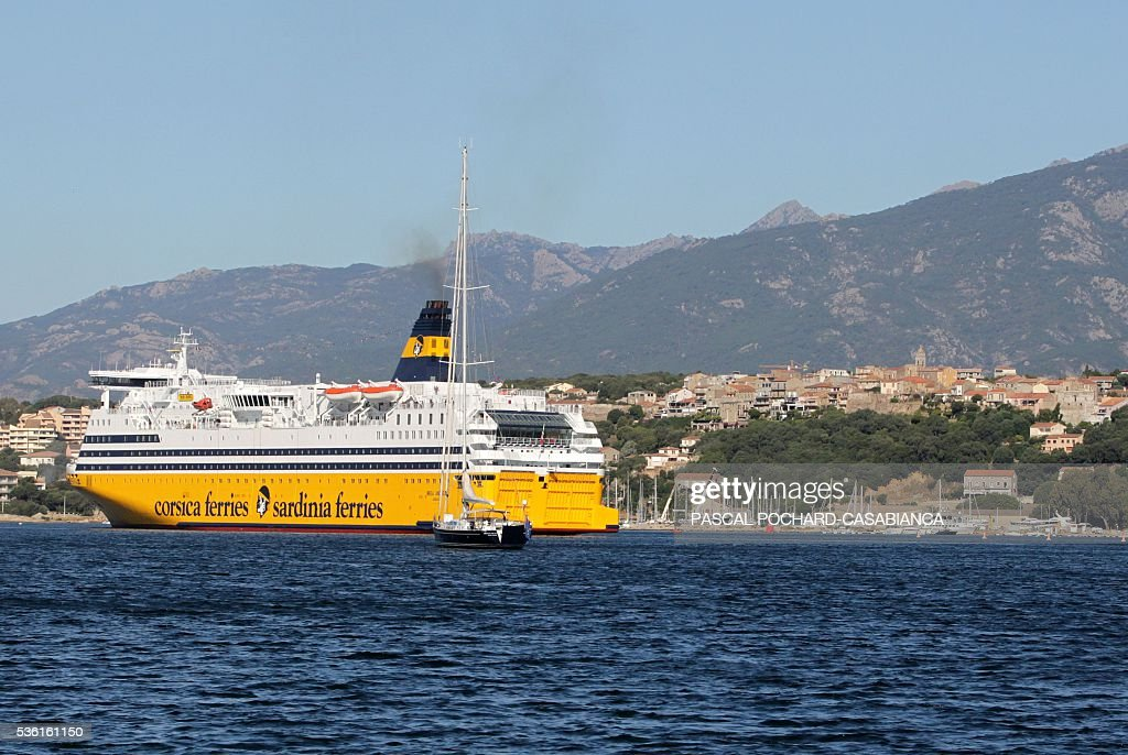 A picture taken on May 31, 2016 shows the new ferry boat Mega Andrea of the French Corsica Ferries company in Porto-Vecchio on the French Mediterranean island of Corsica. The Corsica Ferries opened, on May 31, a new line between Nice, Corsica and the island of Sardegna in Italy, reinforcing its position as a leader for the maritime transport between the two neighbour islands Corsica and Sardegna. / AFP / Pascal POCHARD