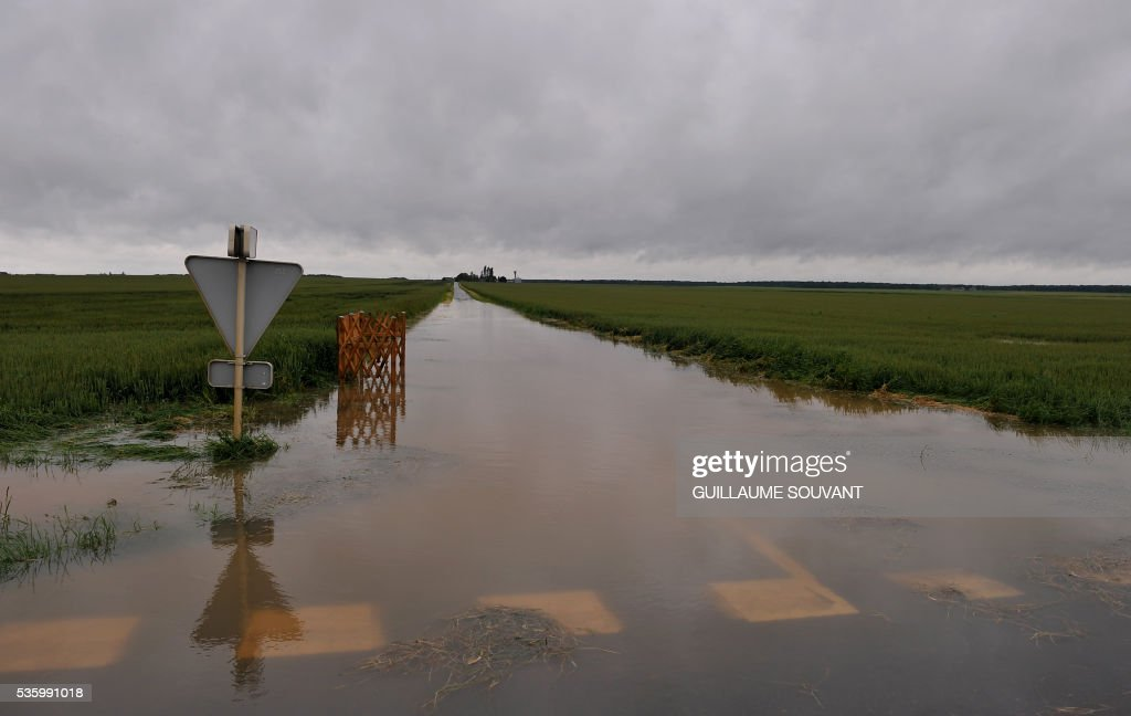 A picture taken on May 31, 2016 southern Orleans, shows a flooded road following heavy rainfalls which have disrupted the traffic on the A10 highway between Paris and Orleans. The Loiret department is under flood alert and France's weather agency Meteo France maintained today 18 departments under orange alert. SOUVANT