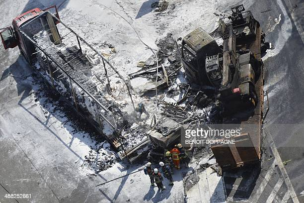 A picture taken on May 5 2014 shows an aerial view of firefighters at the scene of an accident with a truck on the E40 highway in GrootBijgaarden One...