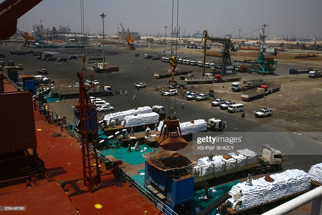A picture taken on May 5, 2016 shows a general view of Sudanese dockers unloading a US aid shipment organised by the US Agency for International Development and the World Food Programme at Port Sudan on the Red Sea coast. Dockers began unloading tens of thousands of tonnes of food from a US aid ship destined for war-torn areas of Sudan, an AFP correspondent reported. The bulk carrier Liberty Grace docked in Port Sudan with a cargo of 47,500 tonnes of sorghum, a staple food in Sudan. SHAZLY