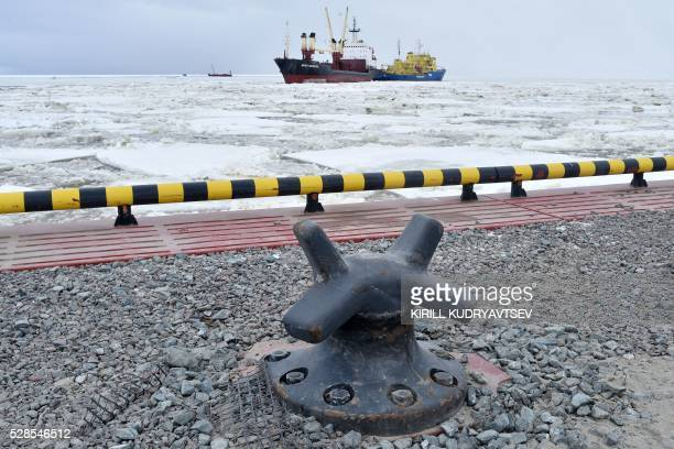 A picture taken on May 5 2016 shows the icebreaker Tor leading a cargo ship at the port of Sabetta in the Kara Sea shore line on the Yamal Peninsula...