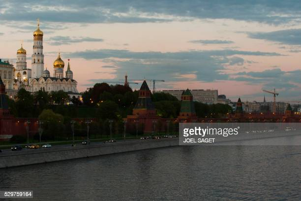 A picture taken on May 6 2016 in Moscow shows the Ivan the Great Bell Tower the tallest of the towers in the Moscow Kremlin complex / AFP / JOEL SAGET