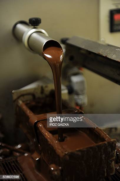 A picture taken on May 6 2016 shows a chocolate fountain in the shop of chocolate maker Pascal Moustirats in Bayonne During two days chocolate makers...