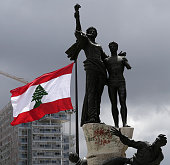 A picture taken on May 6 2016 shows a giant Lebanese flag fluttering next to the landmark Martyrs Statue in Martyrs square in central Beirut at the...