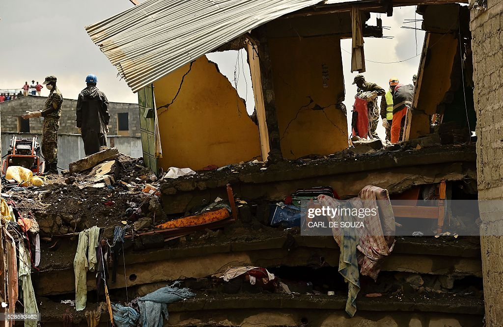 A picture taken on May 6, 2016 shows rubble at the scene of a building collapse which claimed at least 40 lives with more 80 people still unaccounted for, after severe flooding, in the Huruma neighbourhood of Nairobi. Following the collapse, the government has ordered the demolition of similar unsafe buildings in the area. Located in the poor, tightly-packed Huruma neighbourhood, the building, which housed around 150 families crammed into single rooms, had been slated for demolition after being declared structurally unsound. But an evacuation order for the structure, which was built next to a river just two years ago, was ignored. / AFP / CARL
