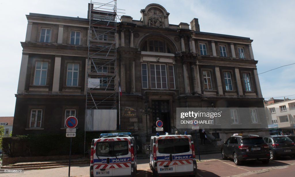 Picture taken on May 6, 2016 shows the facade of the courthouse of Dunkirk, northern France, during the trial of five suspected people-smugglers. A network of five alleged people-smugglers charges of having led into Britain migrants from the Grande-Synthe camp in northern France. The group consisted of five people, three French nationals, a Kurdish man and an Iranian national. / AFP / DENIS