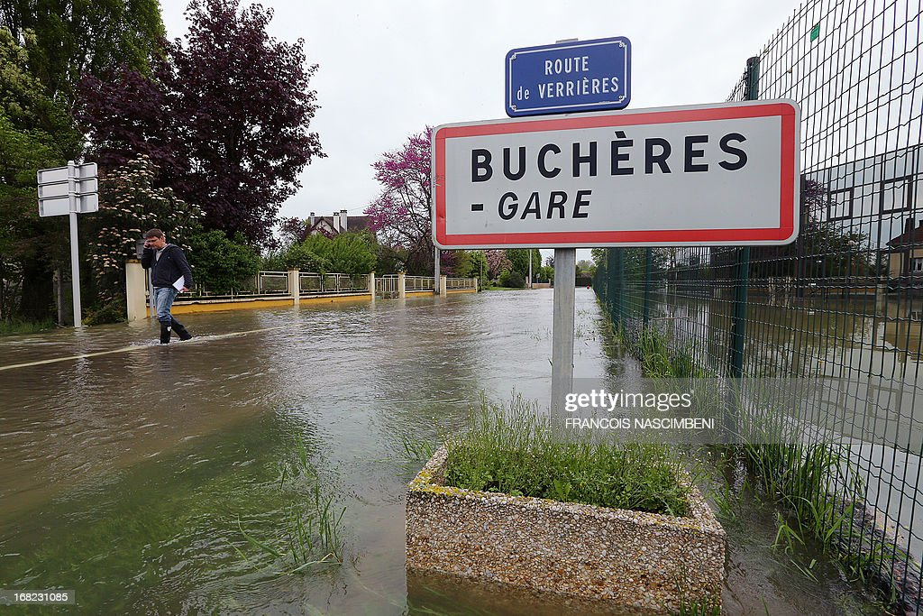 A picture taken on May 7, 2013 shows a sign reading 'Bucheres' at the entrance of the town is pictured in a flooded street of Bucheres, near Troyes, after the Seine river overflowed following heavy rainfalls.