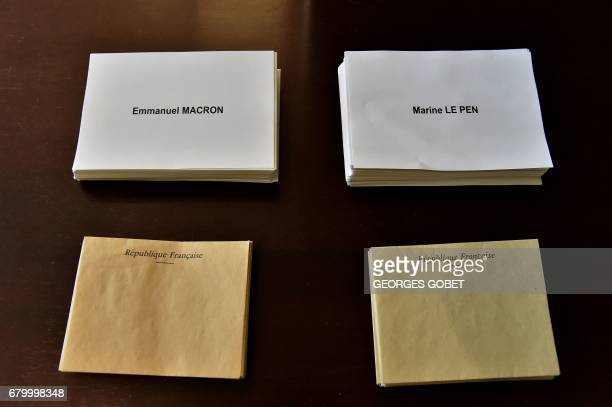 A picture taken on May 7 2017 shows envelopes and ballots at a polling station in Tulle on May 7 during the second round of the French presidential...