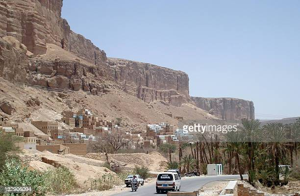 A picture taken on May 9 2011 shows aa mini bus driving on a main road past Rabat Ba Ashan in the southern Yemeni province of Hadramawt the ancestral...