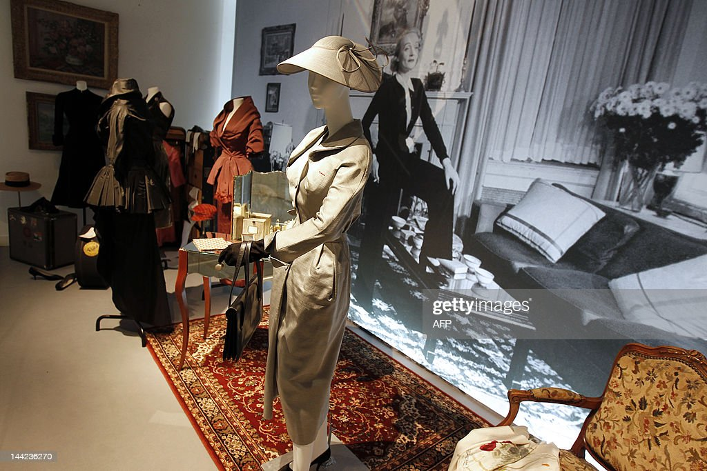 A picture taken on May 9, 2012 shows dresses worn by German-US actress Marlene Dietrich presented at the exhibition 'Stars in Dior' ('Stars en Dior, de l'ecran a la ville') at the Christian Dior museum in Granville, Normandy, France. The exhibit which features a rare collection of glittering gowns, worn by actresses including Grace Kelly, Elizabeth Taylor and Rita Hayworth, both on and off the screen from 1942 to the present day, runs from May 12, to September 23, 2012.
