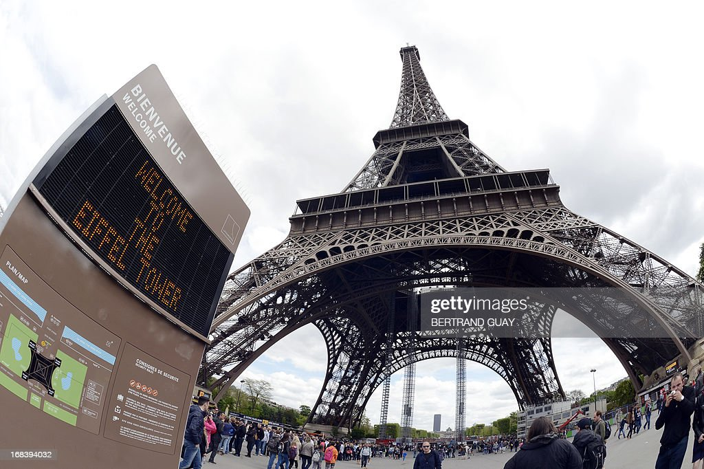 A picture taken on May 9, 2013 in Paris shows the entrance of the Eiffel Tower site. AFP PHOTO / BERTRAND GUAY