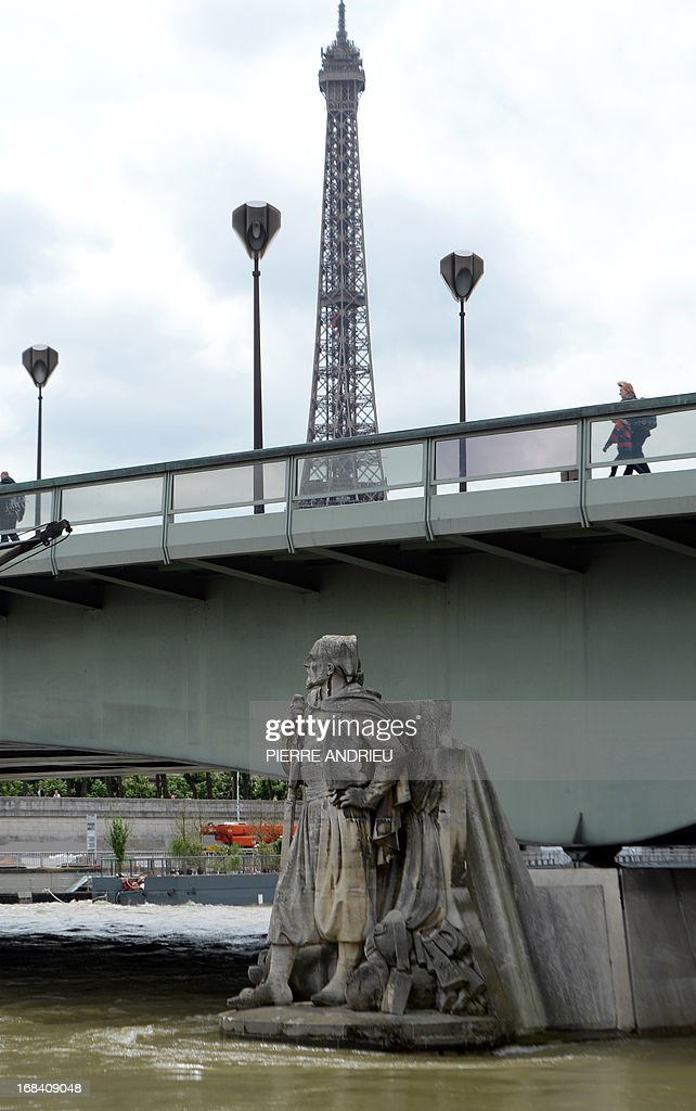 Picture taken on May 9, 2013 shows the statue of a Zouave soldier, in front of the Eiffel tower in Paris. Access to the footpaths by the river embankments usually is closed when the Seine's level reaches the feet of the Zouave, and when the water hits the statue's thighs, the river becomes unnavigable. During the great flood of the Seine in 1910, the level reached to the shoulders of the Zouave.
