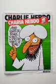 A picture taken on November 1 2011 in Paris shows the cover of an issue of Satirical French magazine Charlie Hebdo to be published on November 2...