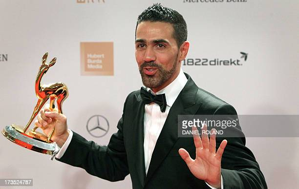 A picture taken on November 10 2011 shows GermanTunisian rap singer Bushido posing with his Integration Prize during the Bambi awards ceremony in...