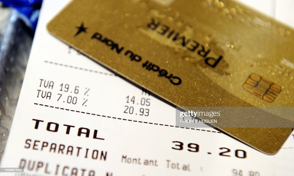A picture taken on November 10, 2012 in a restaurant in Lille shows a credit card set up on a bill with the 19,60 percent value added tax (VAT), and the 7 percent VAT rate. The government announced on November 6, 2012 plans to increase VAT from 19,60% to 20% which is applied to alcoholic drinks sold in bars, cafes and restaurants. The move to increase the rate of value added tax (VAT) charged on restaurant food and hotel accommodation as well, from seven to 10 percent was dubbed 'brutal' by the trade with representative bodies warning it will cost tens of thousands of jobs.