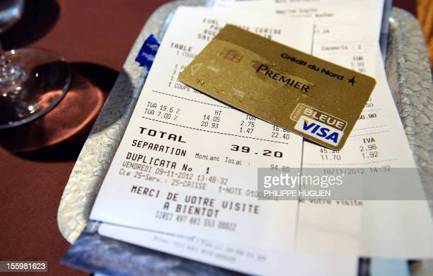 A picture taken on November 10 2012 in a restaurant in Lille shows a credit card set up on a bill with the 1960 percent value added tax and the 7...