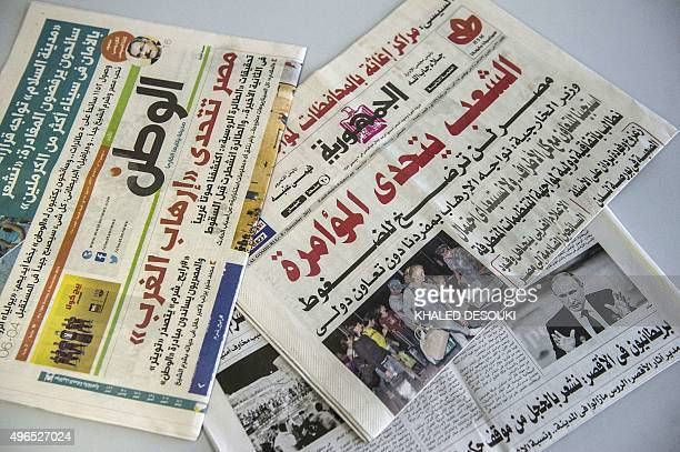 A picture taken on November 10 2015 shows the covers of several Egptian newspapers published on November 8 with headlines denouncing a Western...