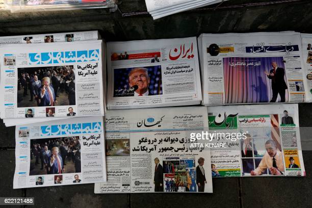 A picture taken on November 10 2016 in the Iranian capital Tehran shows local newspapers displaying articles on US presidentelect Donald Trump a day...