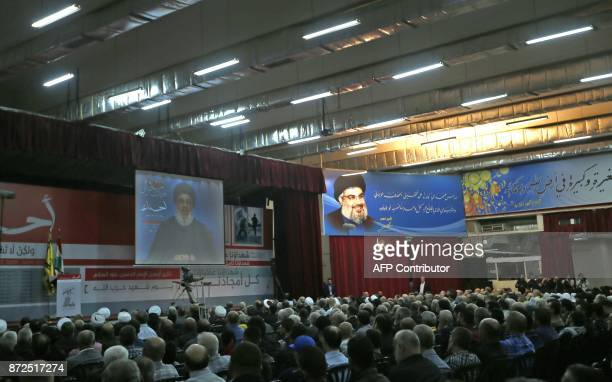 A picture taken on November 10 shows Hassan Nasrallah the head of Lebanon's militant Shiite movement Hezbollah giving a televised address during a...