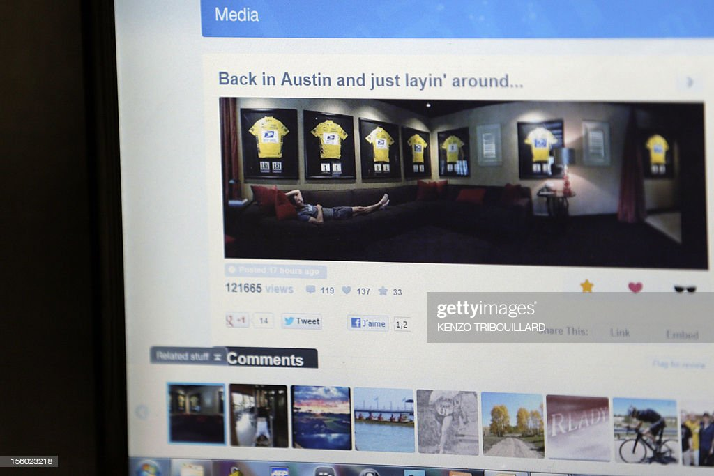 A picture taken on November 11, 2012 in Paris shows a computer screen featuring an web page with a picture posted by disgraced cyclist Lance Armstrong on which he poses provocatively with his framed seven Tour de France winners jerseys in his Austin home. Armstrong was banned on October 22, 2012 by the International Cycling Union (UCI) as the world cycling body upheld an earlier doping sanction handed to the seven-times Tour de France champion.