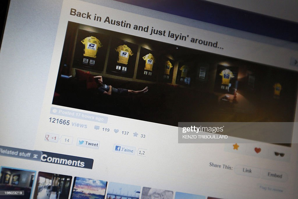 A picture taken on November 11, 2012 in Paris shows a computer screen featuring an web page with a picture posted by disgraced cyclist Lance Armstrong on which he poses provocatively with his framed seven Tour de France winners jerseys in his Austin home. Armstrong was banned on October 22, 2012 by the International Cycling Union (UCI) as the world cycling body upheld an earlier doping sanction handed to the seven-times Tour de France champion. AFP PHOTO KENZO TRIBOUILLARD