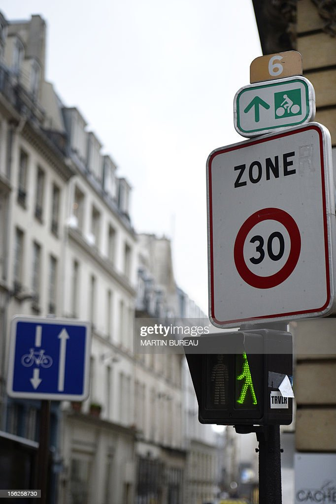 A picture taken on November 12, 2012 shows a road sign announcing a 30 km speed limit zone in Paris. Paris Mayor, Bertrand Delanoe has called for a plan of reduction in the speed limit in order to reduce pollution in the French capital. BUREAU
