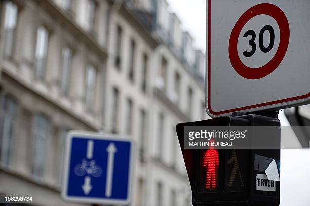 A picture taken on November 12 2012 shows a road sign announcing a 30 km speed limit zone in Paris Paris Mayor Bertrand Delanoe has called for a plan...