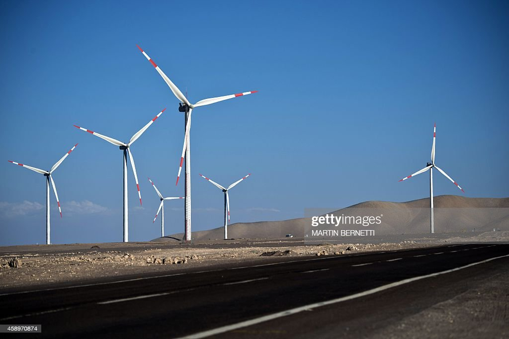 Picture taken on November 13 2014 of wind turbines installed in Calama about 1500 km north of Santiago Chile as part of a nonconventional renewable...