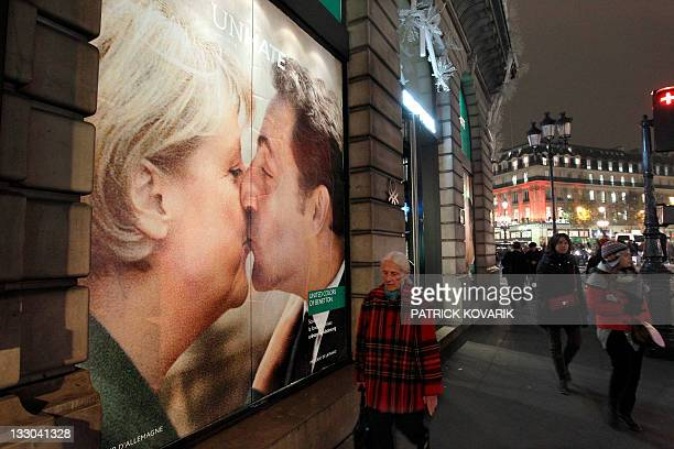 Picture taken on November 16 2011 in Paris shows a Benetton clothing store window covered by a poster showing French president Nicolas Sarkozy...