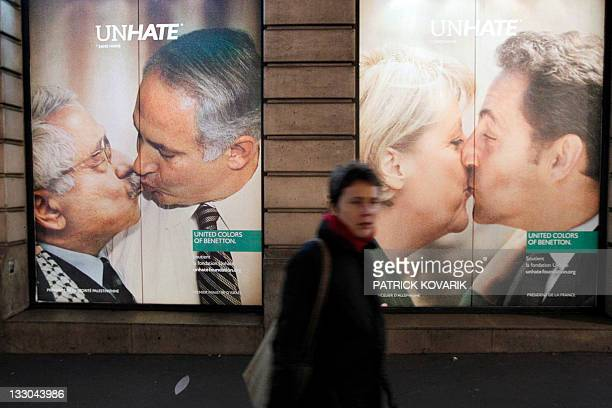 Picture taken on November 16 2011 in Paris shows a Benetton clothing store window covered by posters as part of the launch of a provocative publicity...