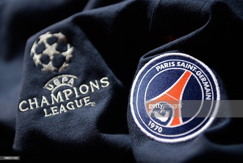 A picture taken on November 16, 2012 in Paris, shows an official jersey of the Paris Saint-Germain football (PSG) club displayed at the club's store on the Champs-Elysees avenue in Paris.