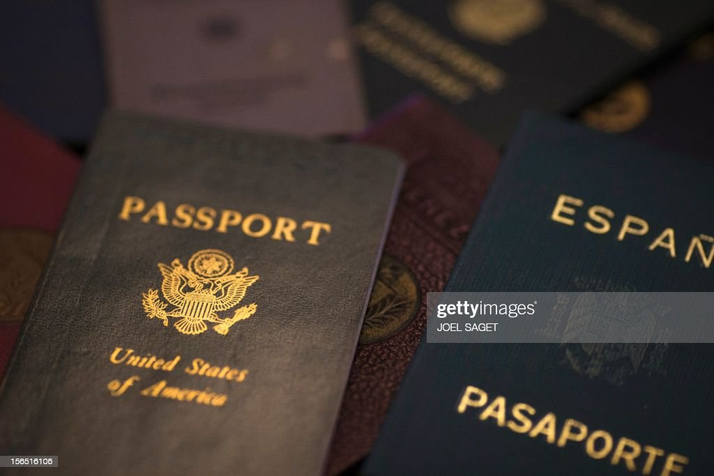 A picture taken on November 16, 2012 in Paris shows fake passports at Argentina's born and French photographer, Adolfo Kaminsky's home. Born in a Jewish family from Russia, Kaminsky is a former French Resistance, who forged identity documents for the National Liberation Front and French draft dodgers during the Algerian War. AFP PHOTO /JOEL SAGET