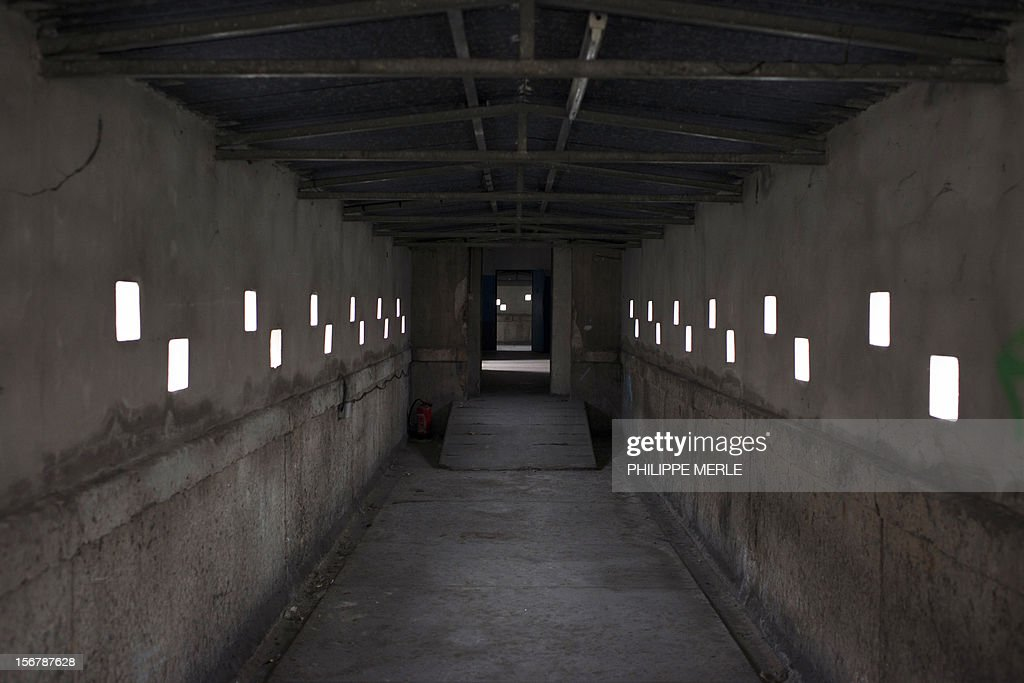 MALLE - A picture taken on November 16, 2012 shows a corridor in the former Saint-Joseph prison in Lyon. The old prison situated in the center of Lyon will become a building complex in a few months, an original initiative in France where the old prisons are generally destroyed. AFP PHOTO PHILIPPE MERLE