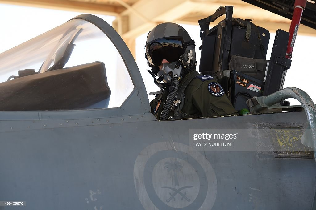 A picture taken on November 16 2015 shows a Saudi pilote sitting in a F15 fighter jet at the Khamis Mushayt military airbase some 880 km from the...